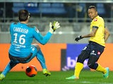 Sochaux French forward Jordan Ayew scores a goal past Bordeaux's French goalkeeper Cedric Carasso during the French L1 football match between FC Sochaux (FCSM) and Girondins de Bordeaux (FCGB) on March 1, 2014