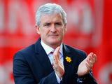Stoke City Manager Mark Hughes walks to the dugout prior to the Barclays Pemier League match between Stoke City and Arsenal at the Britannia Stadium on March 1, 2014