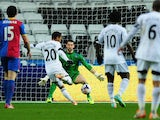 Swansea player Jonathan de Guzman opens the scoring during the Barclays Premier League match between Swansea City and Crystal Palace at Liberty Stadium on March 2, 2014