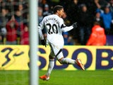 Jonathan de Guzman of Swansea City celebrates scoring the opening goal during the Barclays Premier League match between Swansea City and Crystal Palace at Liberty Stadium on March 2, 2014