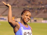 Jamaica's Veronica Campbell-Brown takes the applause after winning the women's 100 meters at the Jamaica international invitational in 11.01 seconds at the national stadium in Kingston on May 4, 2013