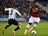 Udinese's Allan Marques Loureiro and AC Milan's Sulley Muntari in action during their Serie A match on March 8, 2014