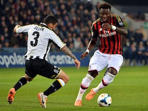 Muntari signs new Milan deal