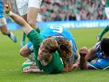 Ireland's Andrew Trimble scores his team's second try against Italy during their Six Nations match on March 8, 2014