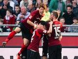 Hannover's Artjoms Rudnevs celebrates with teammates after scoring the equaliser against Bayer Leverkusen during their Bundesliga match on March 8, 2014
