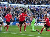 Cardiff City player Steven Caulker celebrates after scoring the opening goal during the Barclays Premier league match between Cardiff City and Fulham at Cardiff City Stadium on March 8, 2014
