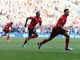 Steven Caulker of Cardiff City celebrates with Kenwyne Jones as he scores their second goal during the Barclays Premier League match between Cardiff City and Fulham at Cardiff City Stadium on March 8, 2014