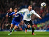 Kyle Walker of Spurs holds off the challenge from Eden Hazard of Chelsea during the Barclays Premier League match between Chelsea and Tottenham Hotspur at Stamford Bridge on March 8, 2014