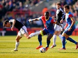 Yannick Bolasie of Crystal Palace takes on Jack Cork of Southampton during the Barclays Premier League match between Crystal Palace and Southampton at Selhurst Park on March 8, 2014