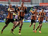 Hull's Curtis Davies celebrates with teammates after scoring the opening goal against Sunderland during their FA Cup quarter-final match on March 9, 2014