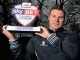 Bury manager David Flitcroft with his February Manager of the Month award on March 6, 2014