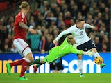 Wayne Rooney of England goes round Kasper Schmeichel of Denmark during the International Friendly match between England and Denmark at Wembley Stadium on March 5, 2014
