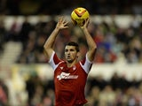 Eric Lichaj of Nottingham Forest taking a throw in during the Sky Bet Championship match between Nottingham Forest and Leeds United at City Ground on December 29, 2013