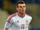 Wales' Gareth Bale celebrates scoring their third goal during the international friendly football match between Wales and Iceland at Cardiff City Stadium in Cardiff, south Wales, on March 5, 2014