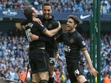 Wigan's James Perch celebrates with teammates after scoring his team's second goal against Manchester City during their FA Cup quarter-final match on March 9, 2014