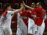 Monaco's James Rodriguez celebrates with teammates after scoring his team's second goal against Sochaux during their Ligue 1 match on March 8, 2014