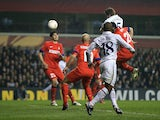 Jan Vertonghen of Tottenham Hotspur heads the ball and scores his side's third goal during the UEFA Europa League match against Inter on March 7, 2013