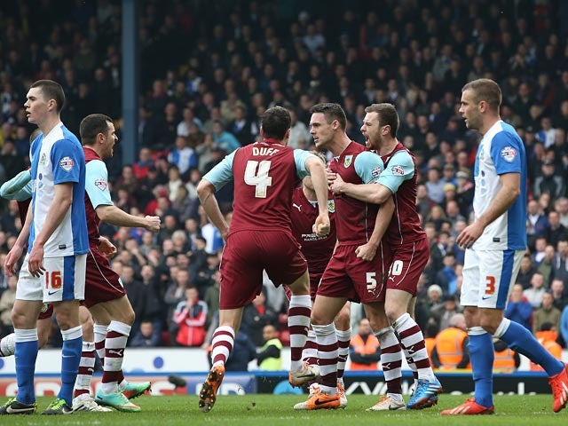 Burnley's Jason Shackell celebrates with teammates after scoring his team's first goal against Blackburn during their Championship match on March 9, 2014