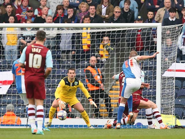 Blackburn's Jordan Rhodes scores the opening goal against Burnley during their Championship match on March 9, 2014