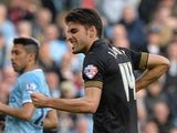 Wigan's Jordi Gomez celebrates after scoring the opening goal against Manchester City during their FA Cup quarter-final match on March 9, 2014