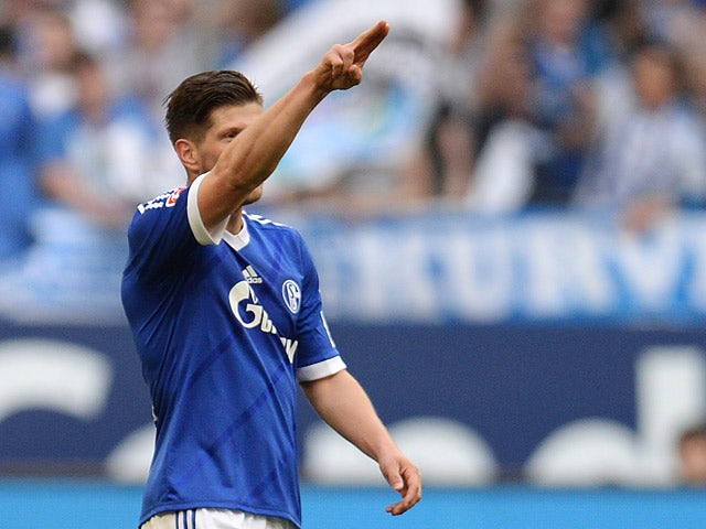Schalke's Klaas-Jan Huntelaar celebrates after scoring the opening goal against Hoffenheim during their Bundesliga match on March 8, 2014