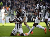 Juventus' Kwadwo Asamoah celebrates with teammates after scoring the opening goal against Fiorentina during their Serie A match on March 9, 2014