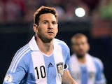 Argentina's forward Lionel Messi celebrates after scoring a goal against Paraguay during a Brazil 2014 FIFA World Cup South American qualifier football match at Defensores del Chaco stadium in Asuncion, Paraguay, on September 10, 2013
