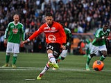 Lorient's French forward Jeremie Aliadiere shoots and scores a penalty shot during the French L1 football match Lorient vs Saint-Etienne on March 9, 2014