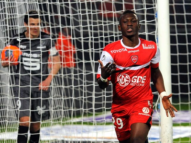Valenciennes's Majeed Waris celebrates after scoring his team's second goal against Rennes during their Ligue 1 match on March 8, 2014