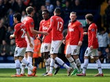 Danny Welbeck of Manchester United celebrates with team mates as he scores their third goal during the Barclays Premier League match between West Bromwich Albion and Manchester United at The Hawthorns on March 8, 2014