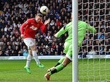 Manchester United's English striker Wayne Rooney heads the ball past to score past West Bromwich Albion's English goalkeeper Ben Foster during the English Premier League football match between West Bromwich Albion and Manchester United at The Hawthorns in
