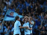 Sydney's Matthew Jurman celebrates with teammates after scoring his team's first goal against Western Sydney during their A-League match on March 8, 2014
