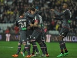 Ajaccio's Mehdi Mostefa is congratulated by teammates after scoring the opening goal against Nantes during their Ligue 1 match on March 8, 2014