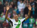 Wolfsburg's Naldo celebrates after scoring the opening goal against Bayern Munich during their Bundesliga match on March 8, 2014