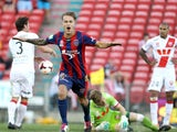 Adam Taggart of the Jets celebrates a goal with Heart players looking dejected during the round 22 A-League match between the Newcastle Jets and Melbourne Heart at Hunter Stadium on March 8, 2014