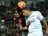 Marseille's Togolese midfielder Jacques-Alaixys Romao vies with Nice's French defender Jordan Amavi during the French L1 football match Olympique de Marseille (OM) vs OGC Nice at the Velodrome stadium in Marseille, on March 7, 2014
