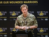 Prince Harry gives a speech at the media launch for the Invictus Games 2014 at the Copper Box Arena in the Olympic Park on March 6, 2014