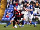Ravel Morrison of Queens Park Rangers holds off the challenge by Nikola Zigic of Birmingham City during the Sky Bet Championship match between Birmingham City and Queens Park Rangers at St Andrews Stadium on March 8, 2014