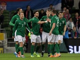 Republic of Ireland's Shane Long celebrates with his teammates after scoring the opening goal of the international friendly football match between the Republic of Ireland and Serbia at Aviva Stadium in Dublin on March 5, 2014