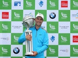 Ross Fisher of England poses with the trophy after winning the Tshwane Open on a score of -20 under par at Copperleaf Golf & Country Estate on March 2, 2014