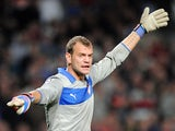 Olympiakos's Irish goalkeeper Roy Carroll gestures during the UEFA Champions League football match Montpellier Herault SC versus Olympiakos FC on October 24, 2012