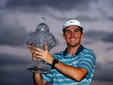 Russell Henley celebrates with the trophy after winning The Honda Classic at PGA National Resort and Spa on March 2, 2014