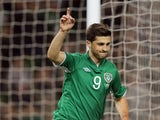 Shane Long of Ireland celebrates scoring a goal during the International Friendly match between Republic of Ireland and Latvia at Aviva Stadium on November 15, 2013