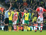 Jonathan Walters of Stoke is shown the red card by referee Andre Marriner following his challenge on Alexander Tettey #27 of Norwich during the Barclays Premier League match between Norwich and Stoke at Carrow Road on March 8, 2014