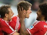 Bayern Munich's Thomas Muller celebrates with teammates after scoring the equaliser against Wolfsburg during their Bundesliga match on March 8, 2014