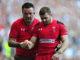 Wales player Leigh Halfpenny is led from the pitch after picking up an injury during the RBS Six Nations match between England and Wales at Twickenham Stadium on March 9, 2014