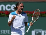 Alexandr Dolgopolov of the Ukraine celebrates his victory over Fabio Fognini of Italy during the BNP Paribas Open at Indian Wells Tennis Garden on March 12, 2014