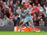 Liverpool's Andrea Dossena celebrates with teammate Ryan Babel after scoring his team's fourth goal against Manchester United during their Premier League match on March 14, 2009