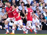 Arsenal's Czech midfielder Tomas Rosicky celebrates after scoring his team's first goal during the English Premier League football match between Tottenham Hotspur and Arsenal at White Hart Lane in north London on March 16, 2014