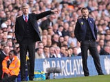 Arsenal's French manager Arsene Wenger instructs his team as Tottenham Hotspur's English Head Coach Tim Sherwood looks on during the English Premier League football match between Tottenham Hotspur and Arsenal at White Hart Lane in north London on March 16